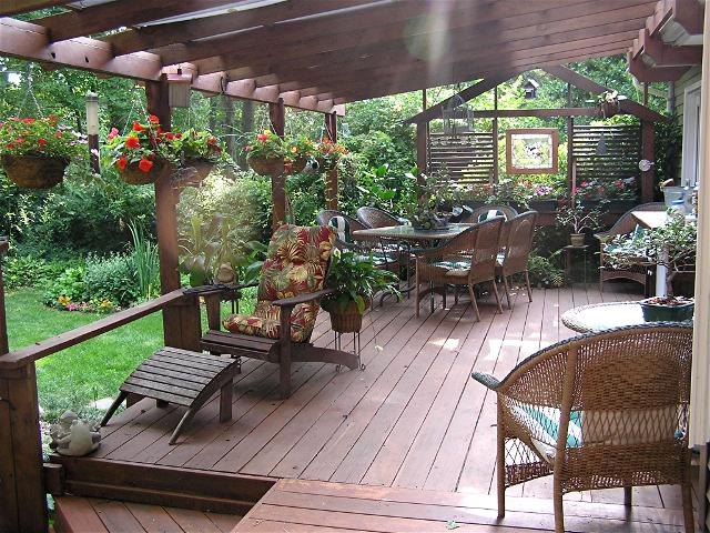 Ideas for patios decks using an automatic plant watering for Patio decorating photos