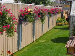 you can use a gravity drip irrigation system for your fence planters